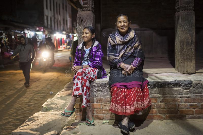 Bhaktapur, Nepal - November 10, 2017. People relaxing in the night at street of Bhaktapur, Nepal. royalty free stock images