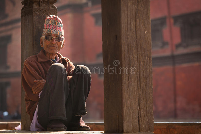 BHAKTAPUR, NEPAL - NOVEMBER 20: Portrait of unkown man staying a royalty free stock images