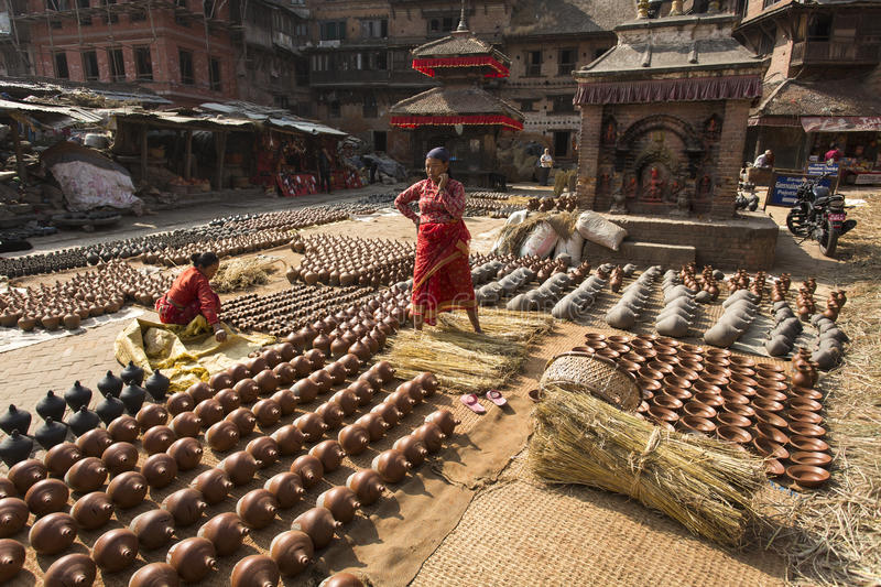 BHAKTAPUR, NEPAL - NOVEMBER 20 :Unidentified woman is molding th stock photo