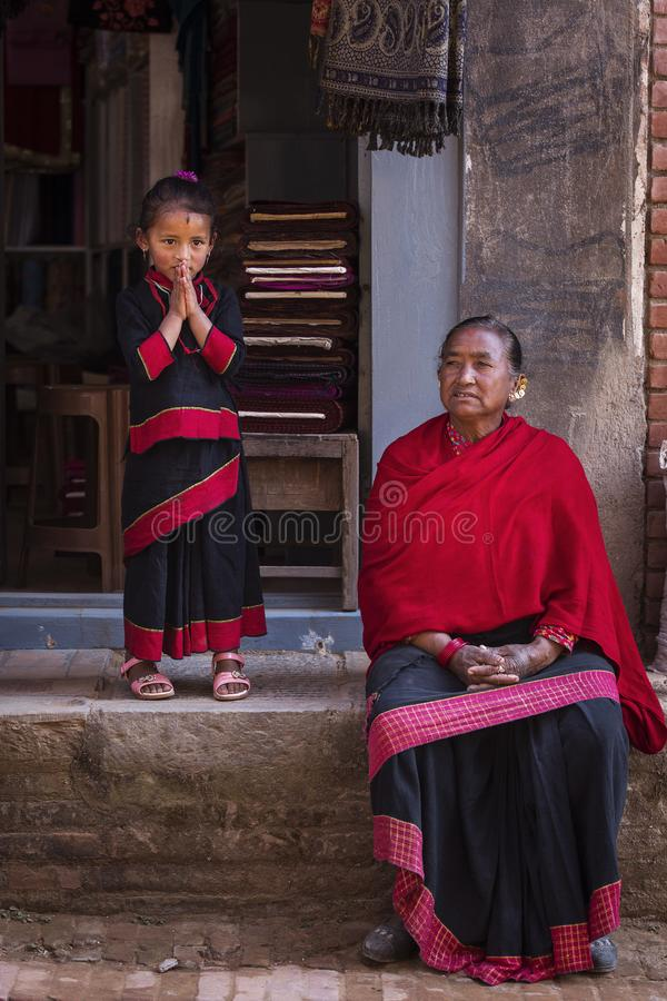 Bhaktapur, Nepal - November 11, 2017. Woman relaxing with her d stock photography
