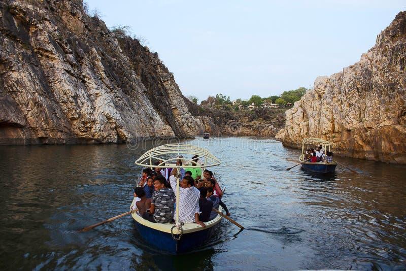 Bhedaghat Madhya Pradesh India. Tourists boating along Narmada river royalty free stock photo