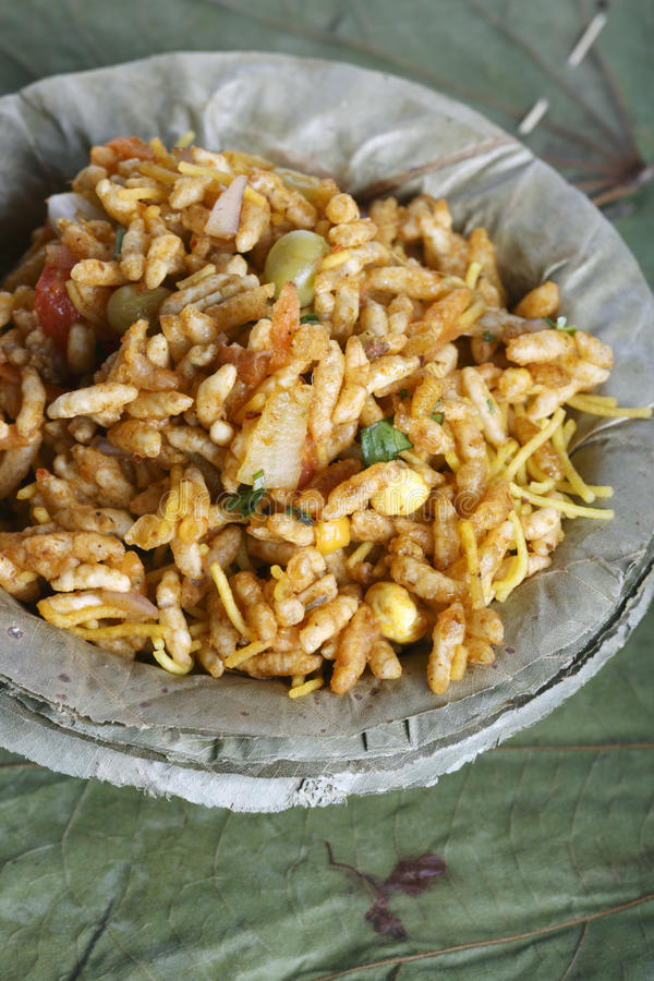 Bhel puri - A street food popular in North India. Bhel puri - Bhelpuri is a type of chaat or small plates of savory snacks, particularly identified with the royalty free stock photos