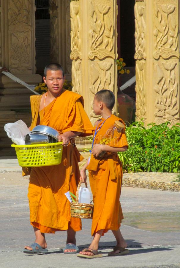 Young Buddhist monk samanera in Thailand temple wat walking on the street royalty free stock photo