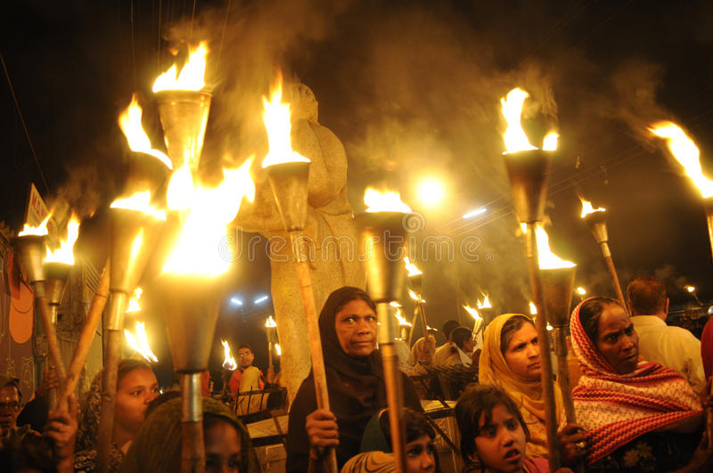 Bhopal Torch Rally. BHOPAL- DECEMBER 2: Protesters and victims gather around the Bhopal Mother Statue during the torch rally to mark the 26th year of Bhopal gas royalty free stock image