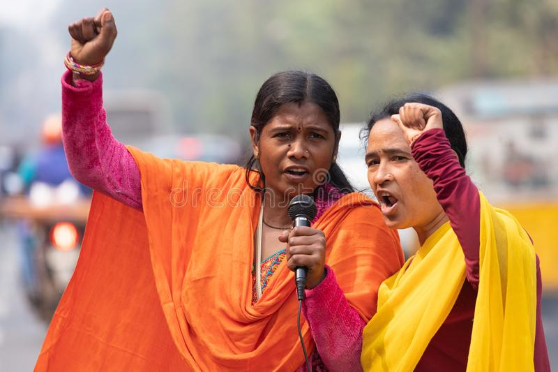 Indian woman demonstration leaders. BHUBANESWAR, INDIA, JANUARY 11, 2019 : Two demonstration leaders are talking in microphone to fight against their retirement stock photo