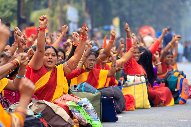 Indian women street demonstration. BHUBANESWAR, INDIA, JANUARY 11, 2019 : Women government officers are protesting in the street against the income lowering of royalty free stock image