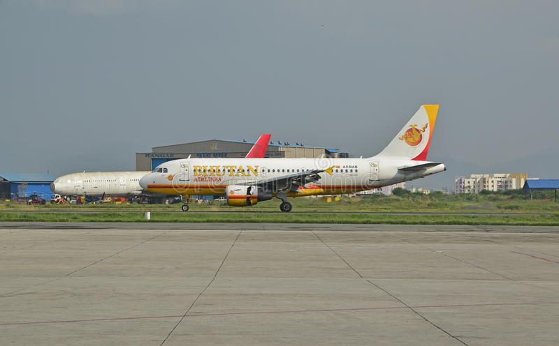 Bhutan Airlines at Nepal Tribhuvan International Airport. This is an Airbus A319-100 with 122 passenger seat, commercial passenger twin-engine jet aircraft seen stock photography