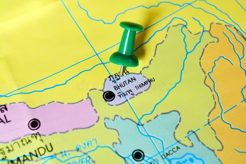 Bhutan map. Macro shot of bhutan map with push pin royalty free stock image