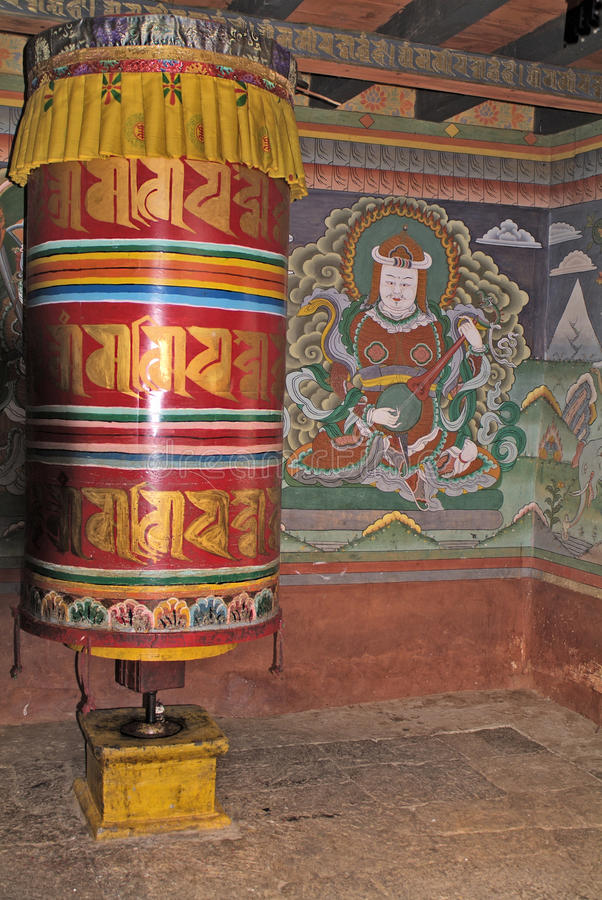 Bhutan, prayer wheel. And religious wall painting in public Chime Lhakhang in Lobesa royalty free stock image