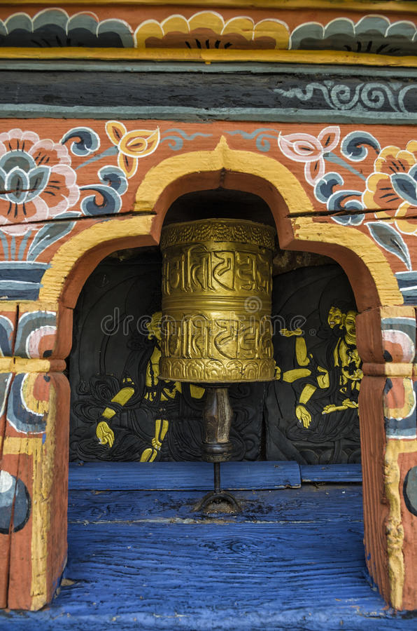 Bhutanese buddism praying wheels at Chimi Lhakang Monastery, Punakha, Bhutan. Chimi Lhakhang, also known as Chime Lhakhang or Monastery or temple, is a Buddhist stock images