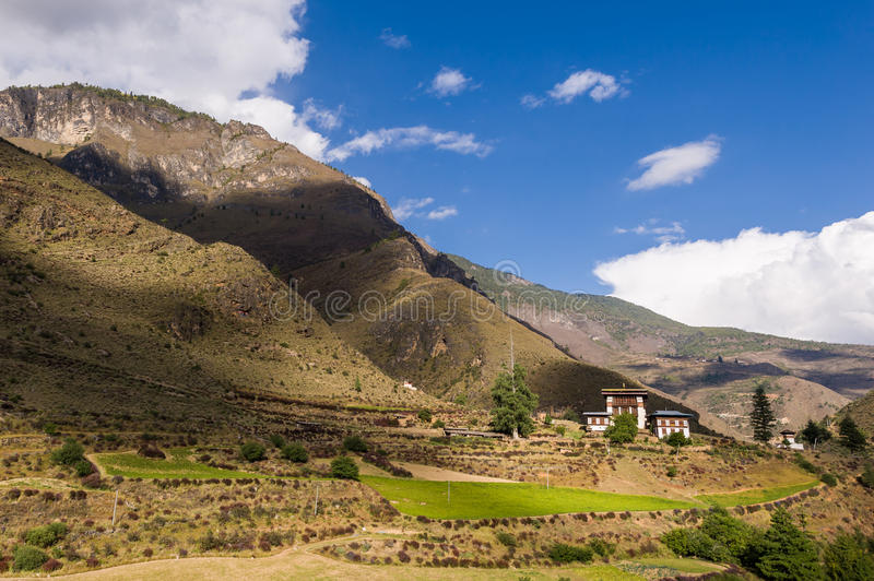 Bhutanese house at foot of mountain royalty free stock photography