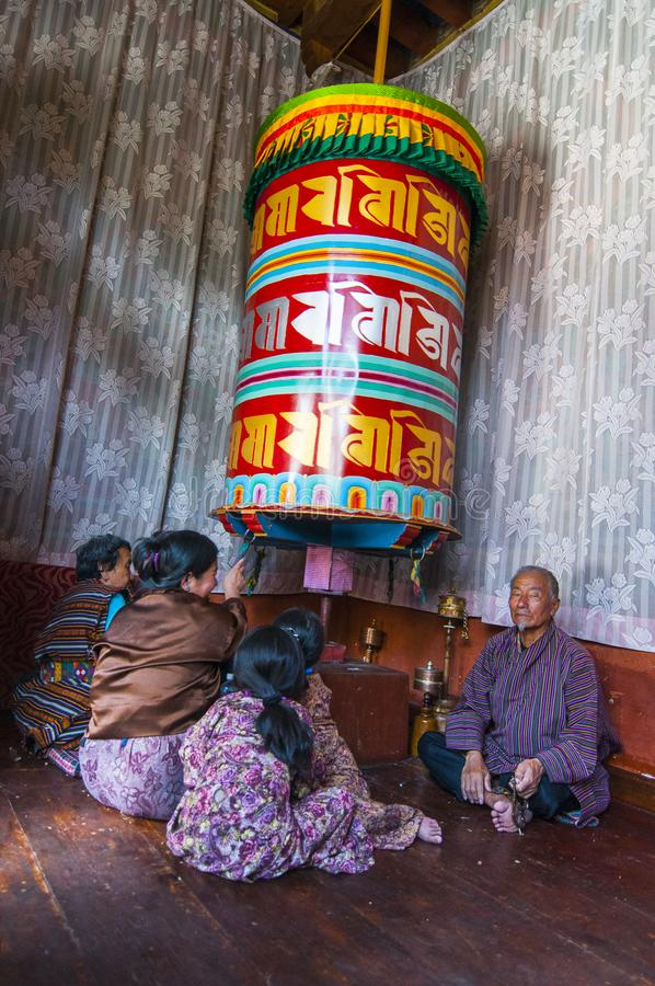 Bhutanese People rotating prayer wheels , Thimphu , Bhutan. No matter younger or elder , Bhutanese people would rotating the prayer wheels , whether hand held or stock images