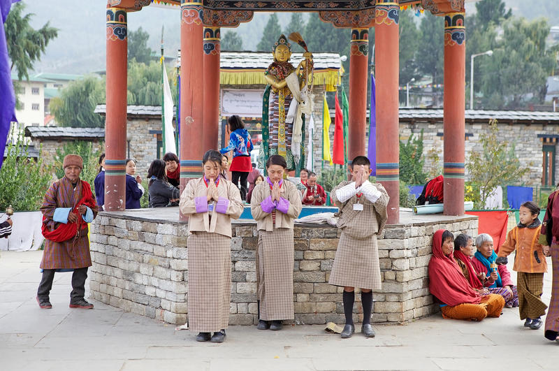 Bhutanese students at the Memorial Chorten, Thimphu, Bhutan. Bhutanese students are praying at the Memorial Chorten, Thimphu, Bhutan. The Memorial Chorten was royalty free stock images