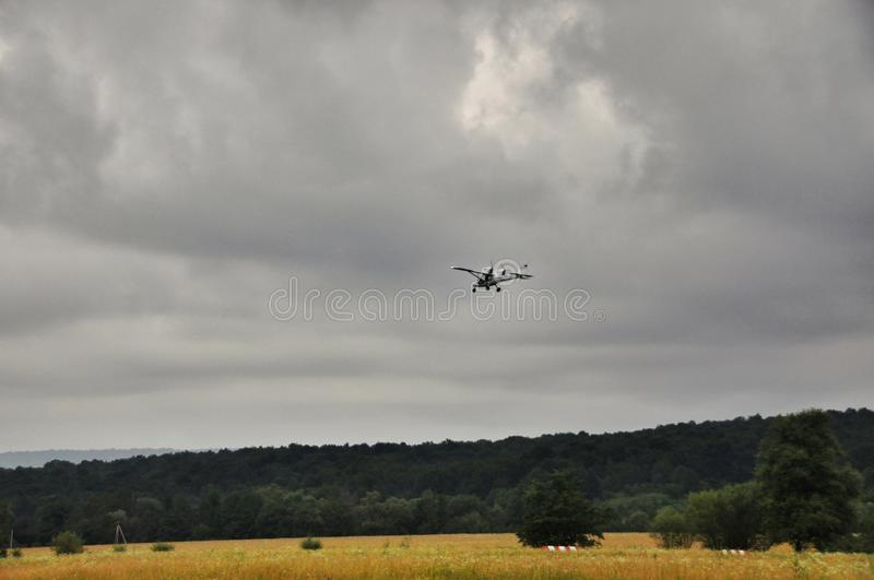 Bi-plane at the airfield. The plane in a field at the airport at the foot of the Caucasus mountains royalty free stock photography