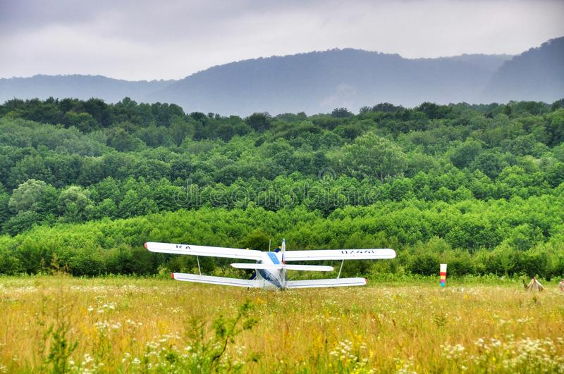 Bi-plane at the airfield. The plane in a field at the airport at the foot of the Caucasus mountains stock images