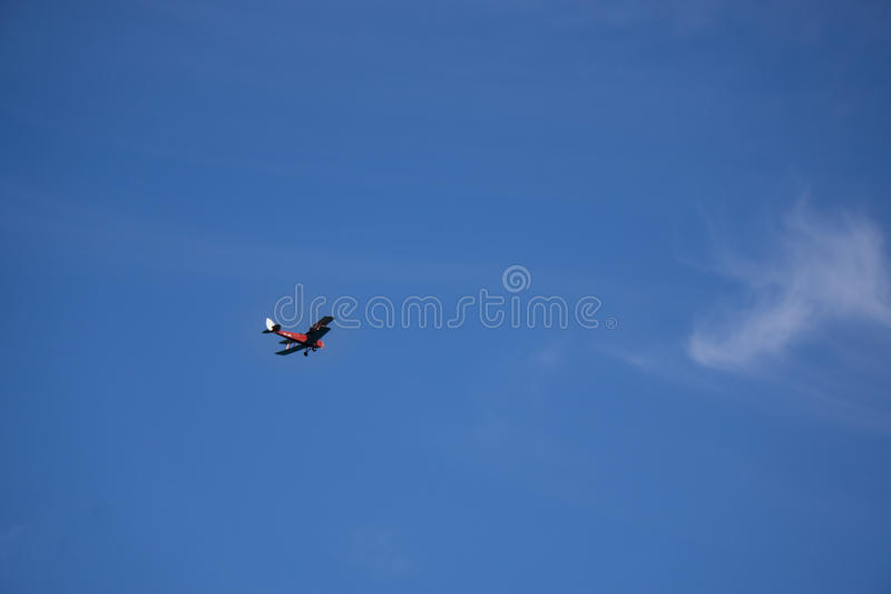 Bi-Plane on blue sky 1 royalty free stock image