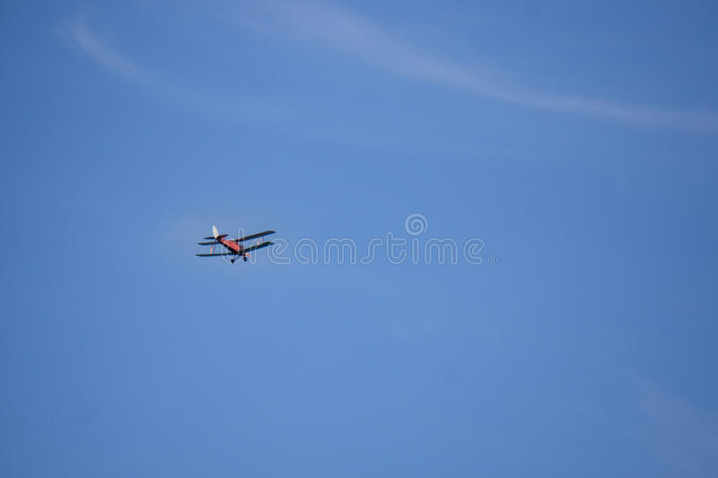 Bi-Plane on blue sky 2 stock photos