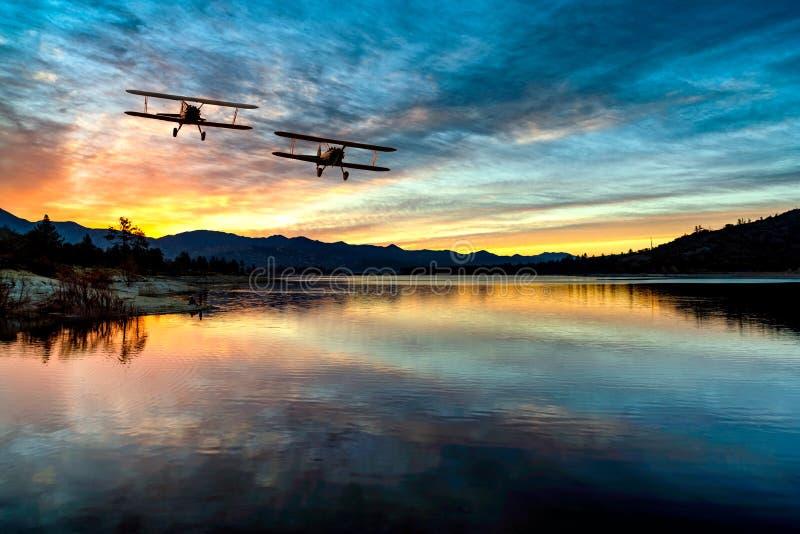 BI PLANE OVER LAKE HEMET,CA royalty free stock photo