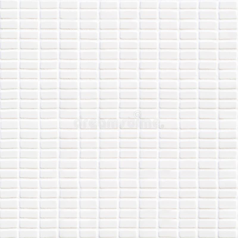 Biała ceramiczna płytka z bardzo małymi prostokątami w kwadrat formie obraz royalty free