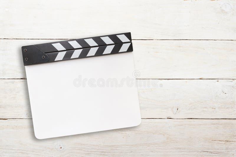 Biała clapper deska na drewnianym tle fotografia royalty free