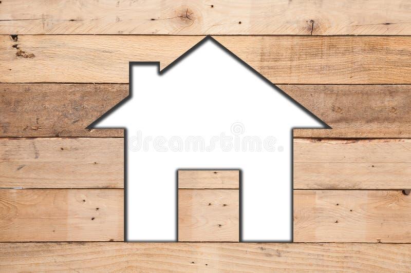 Biała domowa ikona na drewnianej teksturze zdjęcie royalty free