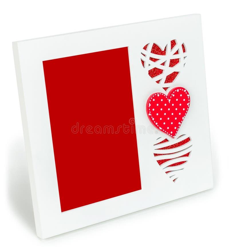 Biała fotografii rama z czerwonymi sercami na isolaed tle obrazy royalty free