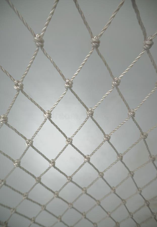 Biała Plastikowa nylon sieć Od arkany na Białym tle Polypropylene Przekręcająca arkany sieć obraz stock