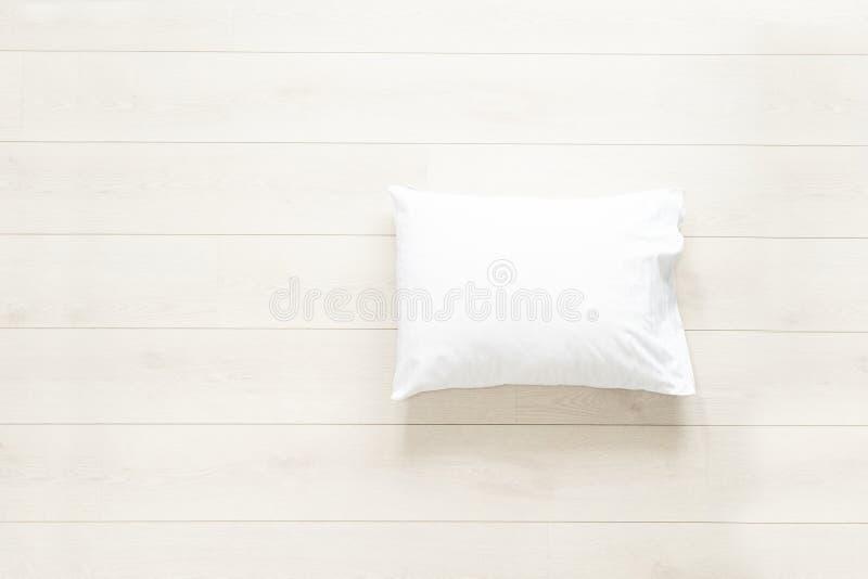 Biała poduszka na podłoga fotografia royalty free