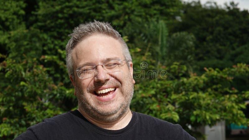Biała samiec I śmiech zdjęcia stock