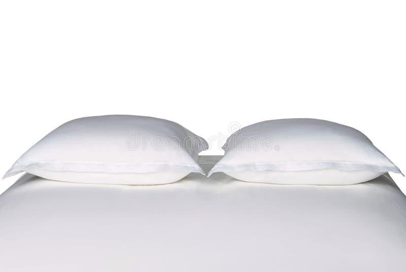 Białe poduszki na łóżku fotografia stock