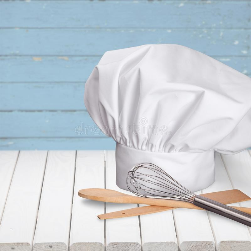 Białe szef kuchni kuchni i kapeluszu dostawy zdjęcie royalty free