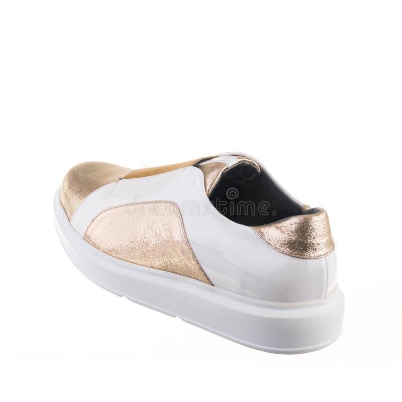 Białego odosobnionego tła białego złota kobiety przypadkowi buty ustawiający zdjęcia royalty free
