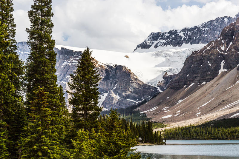 Biały śnieg łęku lodowiec zdjęcia stock