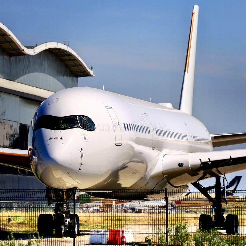 Biały etykietka samolot fotografia stock