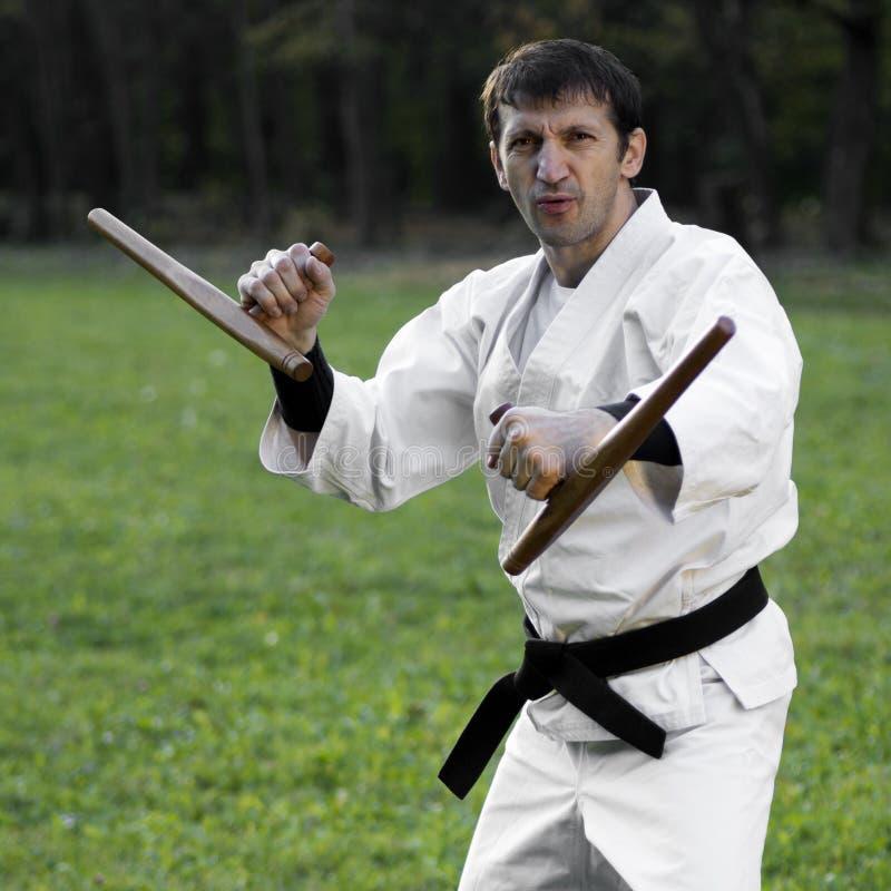 Biały ninja z tonfa zdjęcia stock