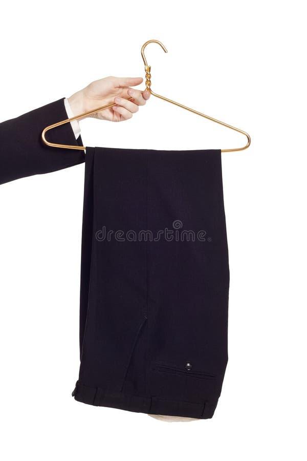 biały odosobneni wieszaków spodnia obraz royalty free