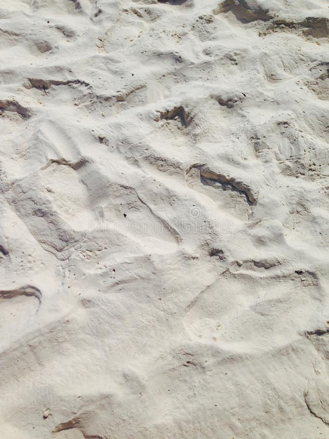 biały piasek na morzu i słońce, fotografia royalty free