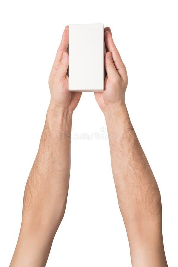 Biały prostokątny pudełko w męskich rękach Odgórny widok isolate obrazy royalty free