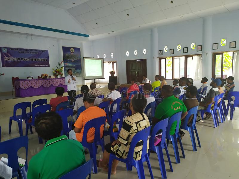 Community meeting about cleanliness at biak-papua. Biak, Papua - 17 August 2019 one afternoon all the janitors street sweepers held a meeting to clean up the stock images