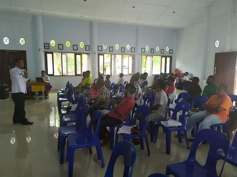 Community meeting about cleanliness at biak-papua. Biak, Papua - 17 August 2019 one afternoon all the janitors street sweepers held a meeting to clean up the stock photos