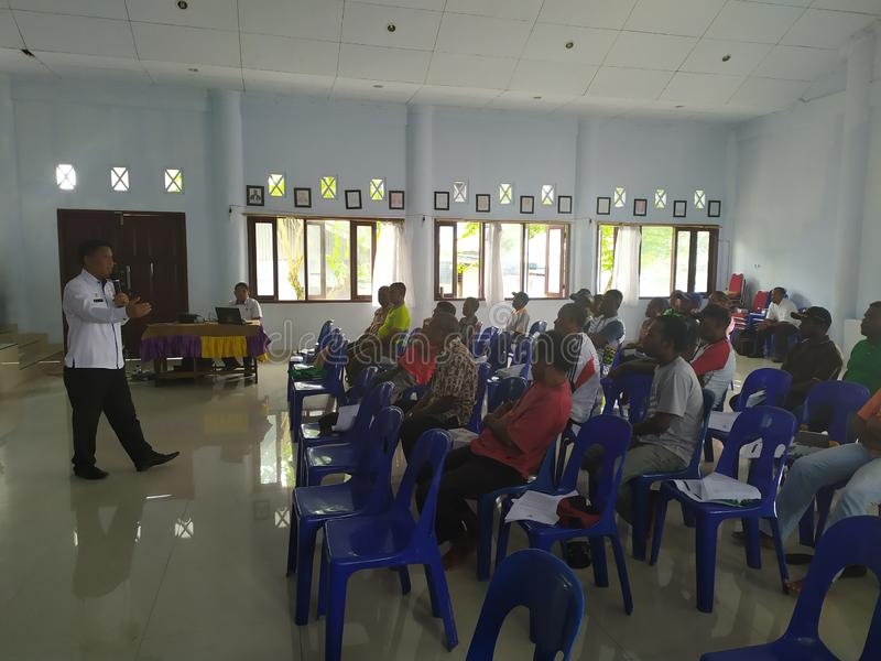 Community meeting about cleanliness at biak-papua. Biak, Papua - 17 August 2019 one afternoon all the janitors street sweepers held a meeting to clean up the royalty free stock photo