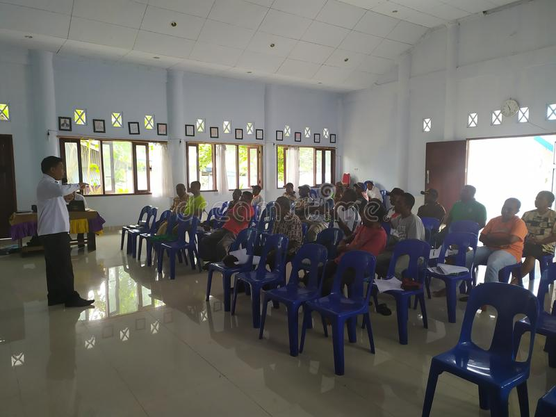 Community meeting about cleanliness at biak-papua stock photo
