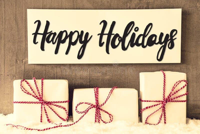 Biali prezenty, znak, kaligrafia Szczęśliwi wakacje, śnieg fotografia royalty free