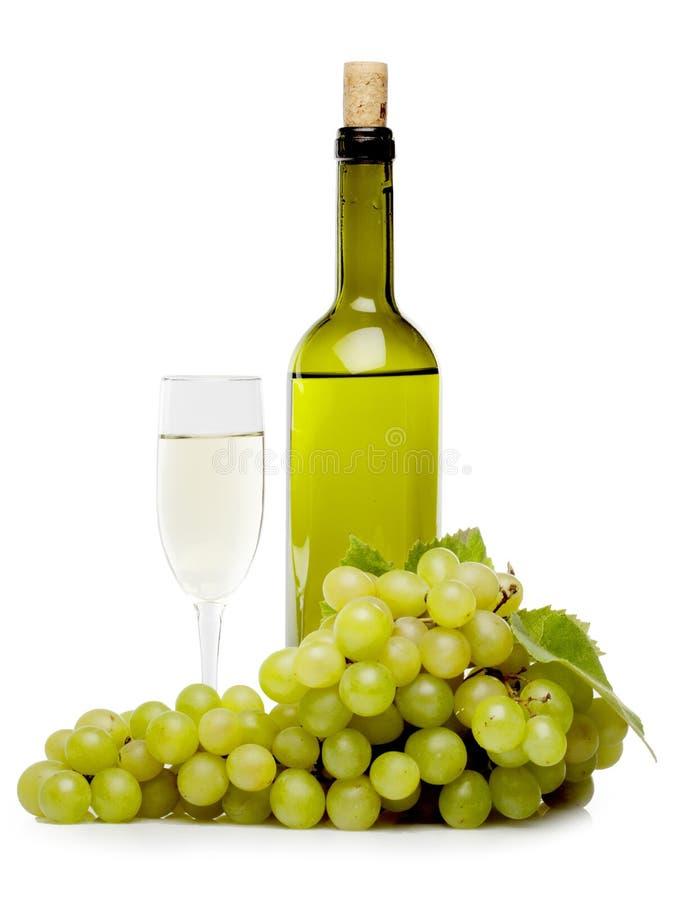 Biali winogrona z wino butelką i winem zdjęcia royalty free