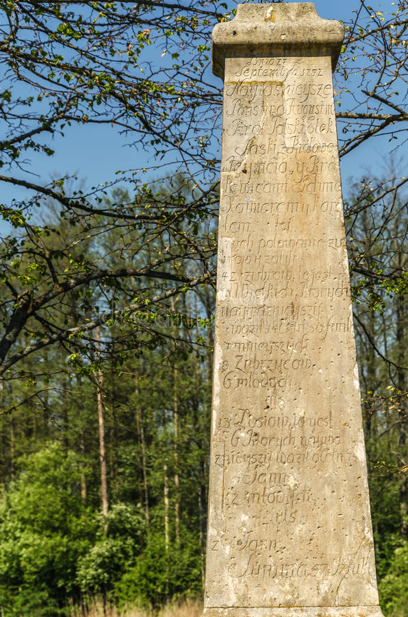 Bialowieza forest in Poland. Entrance to the national park with an obelisk as a commemoration of the king's August III Sas hunting stock image