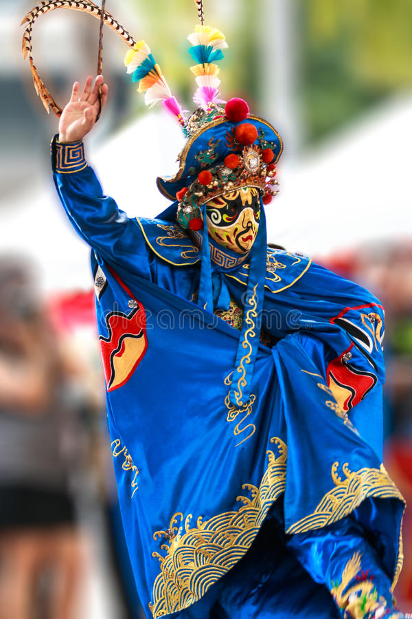 Bian Lian. Is an ancient Chinese dramatic art that is part of the more general Sichuan opera. Performers wear brightly colored costumes and move to quick royalty free stock photo