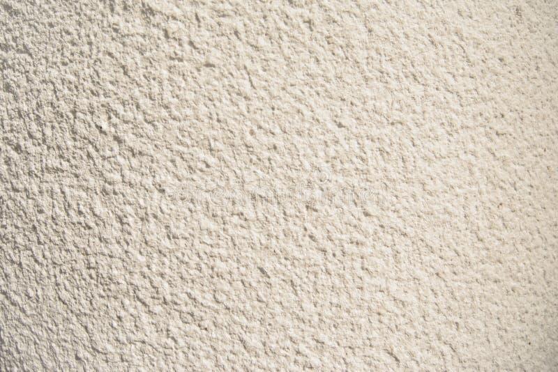 Bianco di lerciume e dell'annata, crema o fondo beige di cemento naturale o di vecchia struttura di pietra, retro parete del mode fotografia stock