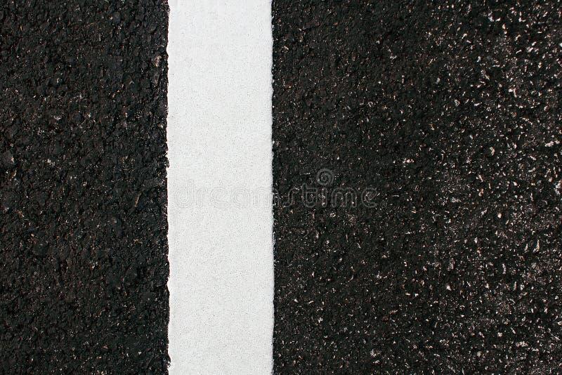 bianco dipinto su asfalto fotografia stock libera da diritti
