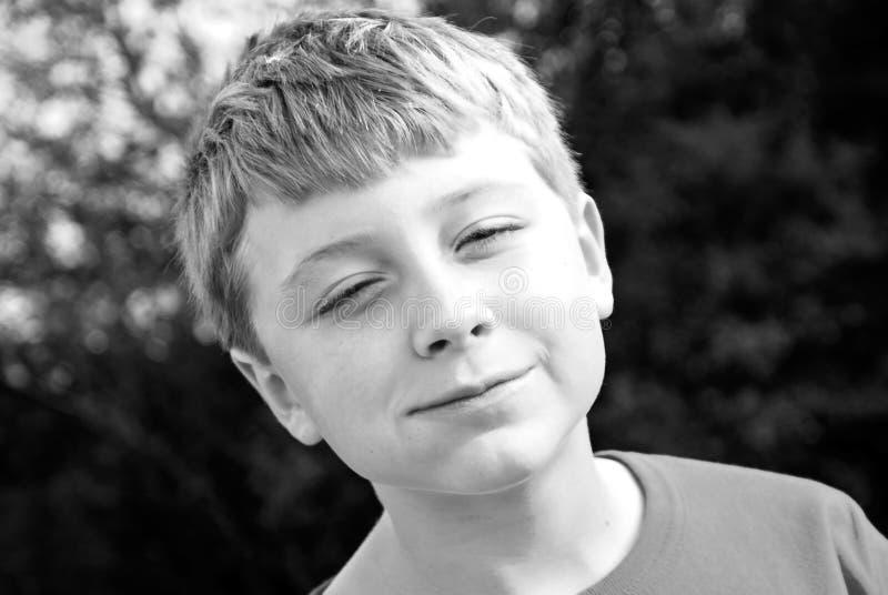 bianco nero di espressione del ragazzo fotografia stock libera da diritti