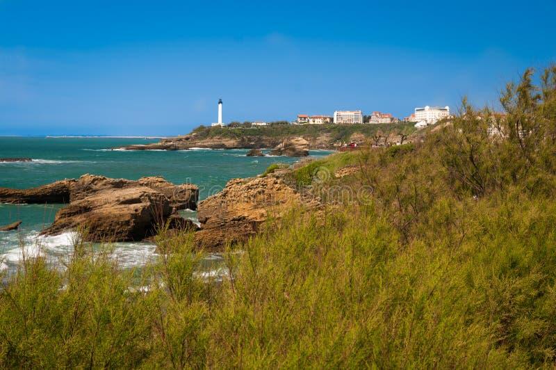 Biarritz - fyr och hav fotografering för bildbyråer